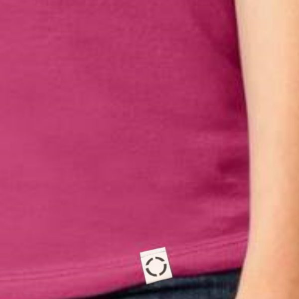Ladies Pink One shirt with woven label close up.
