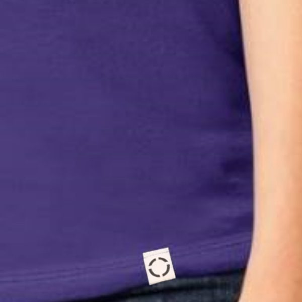 Ladies Purple One shirt with woven label close up.